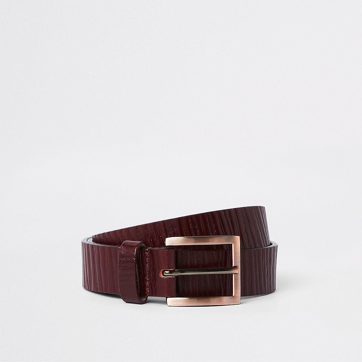 Dark red textured leather belt