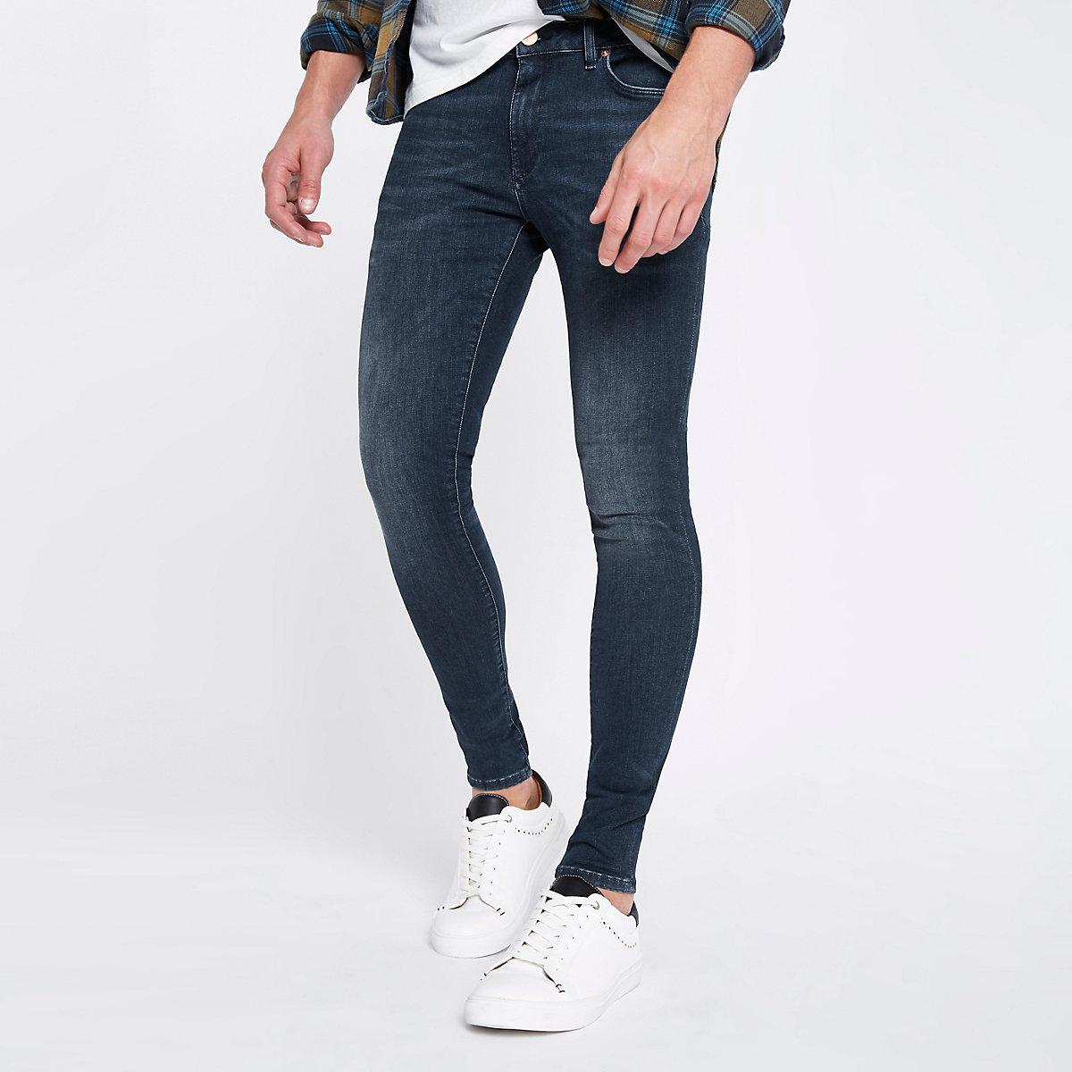 Dark blue Ollie super skinny spray on jeans