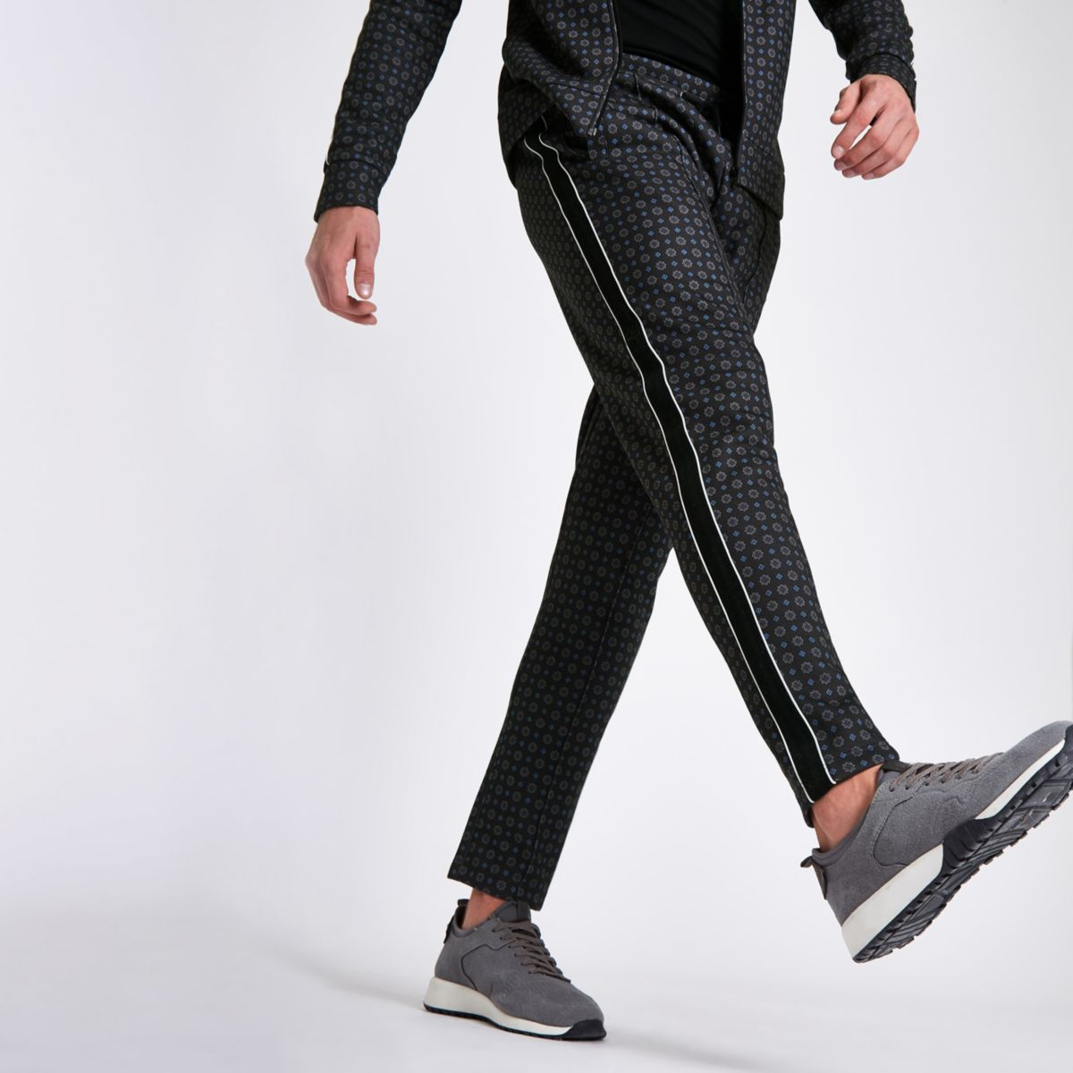 Navy tile print slim fit tape side trousers