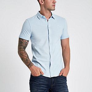 Chemise bleue ajustée à manches courtes en piqué