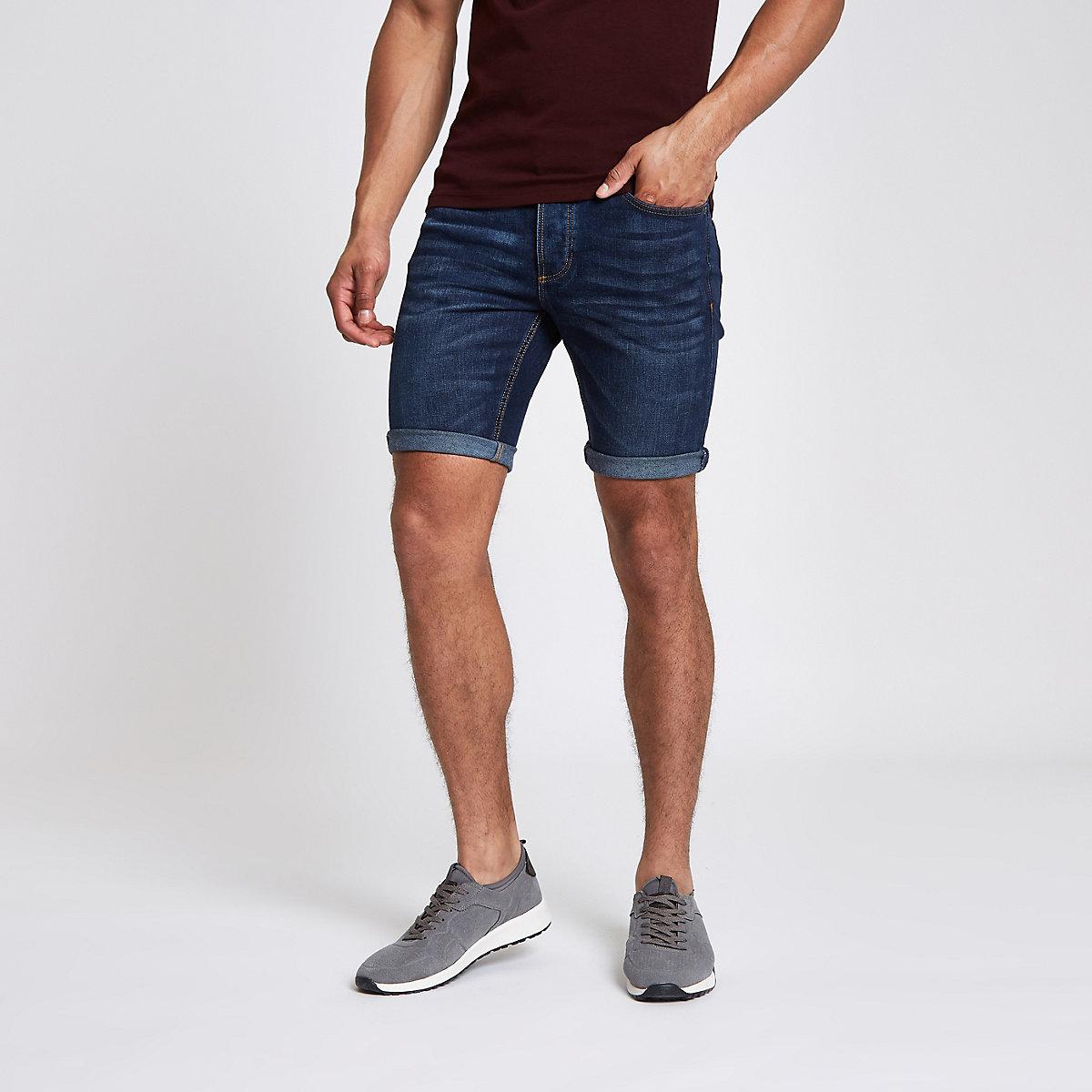 Dark denim skinny rolled hem shorts
