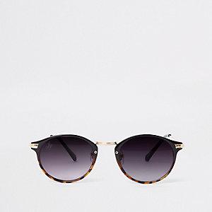 Bruine ronde tortoise zonnebril met goudkleurige accenten