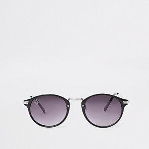 Zwarte ronde zonnebril met zilverkleurige accenten