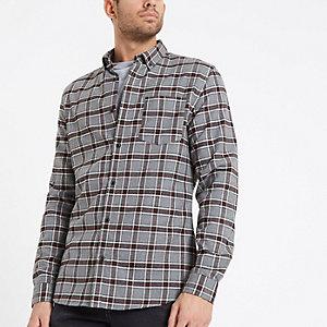 Chemise à carreaux gris et noirs boutonnée