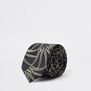 Cravate de luxe noire à imprimé doré