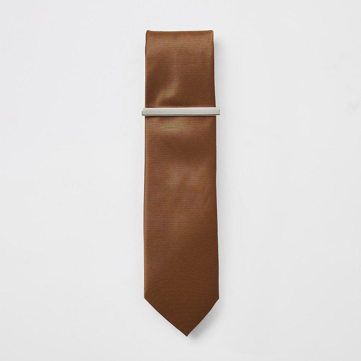 Brown textured tie and tie clip
