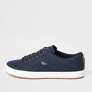 Lacoste – Baskets en cuir bleu marine à lacets