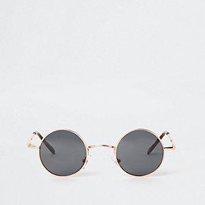 Petites lunettes de soleil rondes dorées à verres fumés