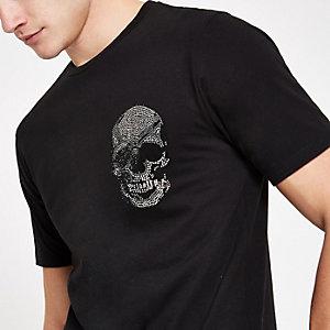 Zwart T-shirt versierd met diamantjes en doodshoofdprint