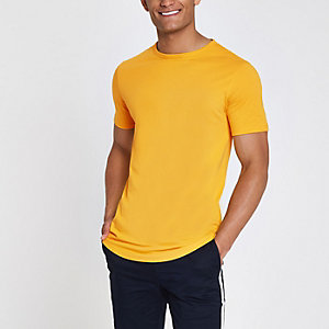 ​​T-shirt long jaune à ourlet arrondi