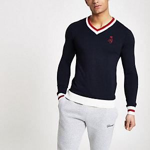 Marineblauwe aansluitende pullover met V-hals en contrasterend randje