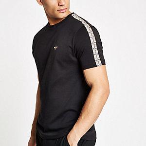 T-shirt noir avec bandes à carreaux aux manches