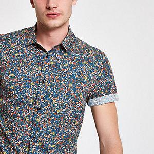 Chemise bleue à manches courtes et imprimé petites fleurs