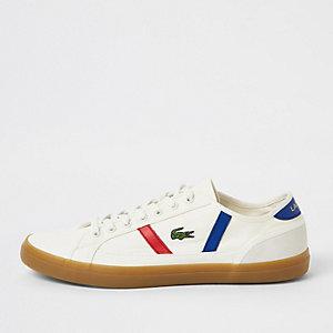 Lacoste - Witte sneakers met bies opzij