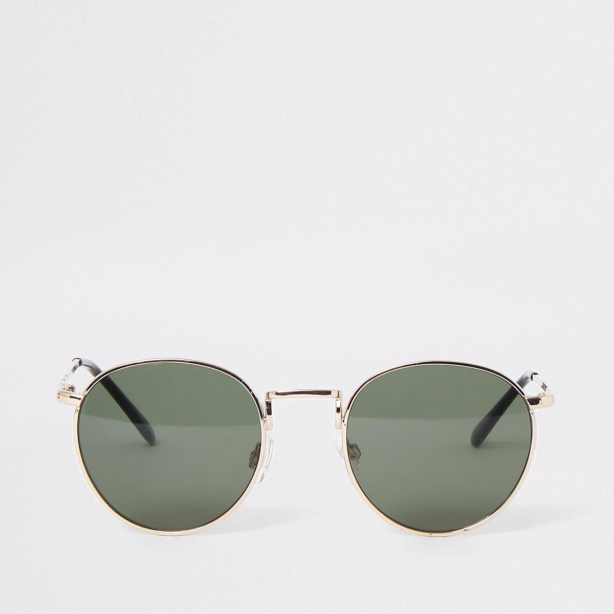 Gold color round sunglasses