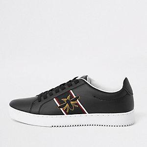 Zwarte sneakers met geborduurde wesp