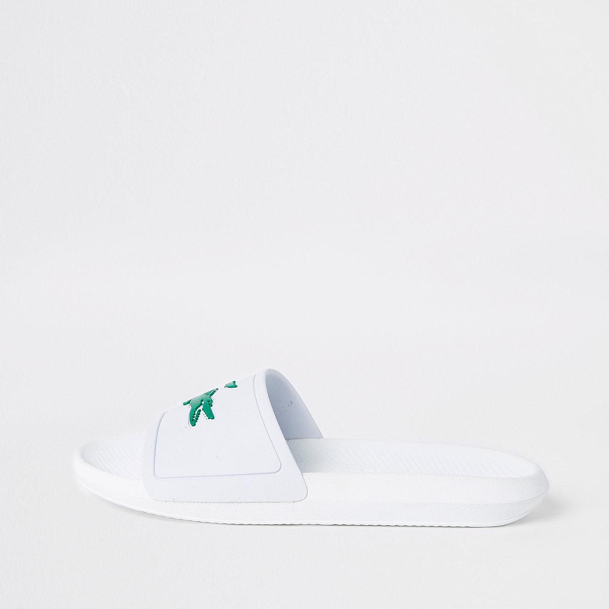 Lacoste white embossed sliders