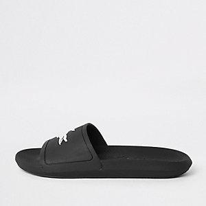 Lacoste black embossed sliders