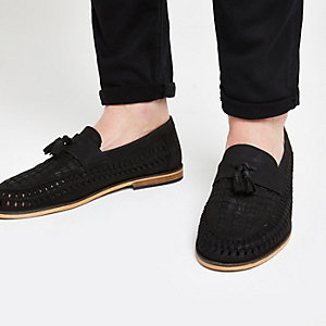 Schwarze Loafer aus Leder mit Quaste