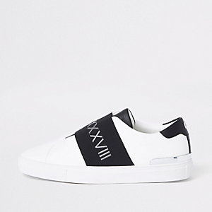 White elastic slip on runner sneakers
