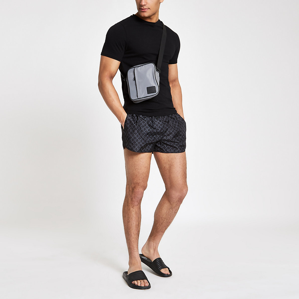 Black RI monogram print swim trunks