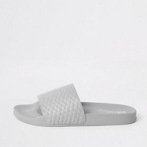 Claquettes motif géométrique texturées grises