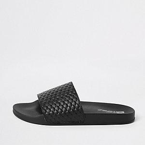 Claquettes à motif géométrique texturées noires