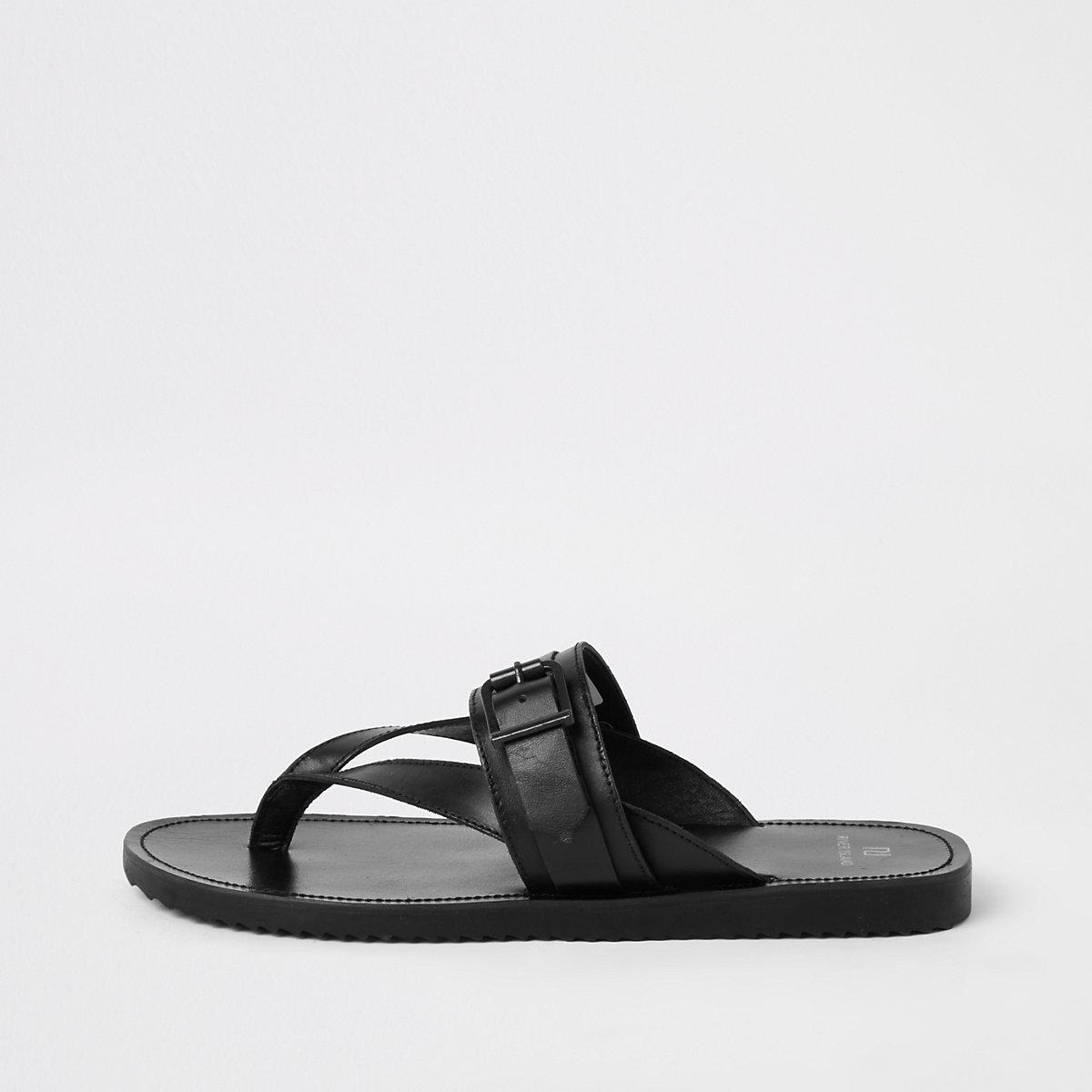 Black leather buckle flip flops