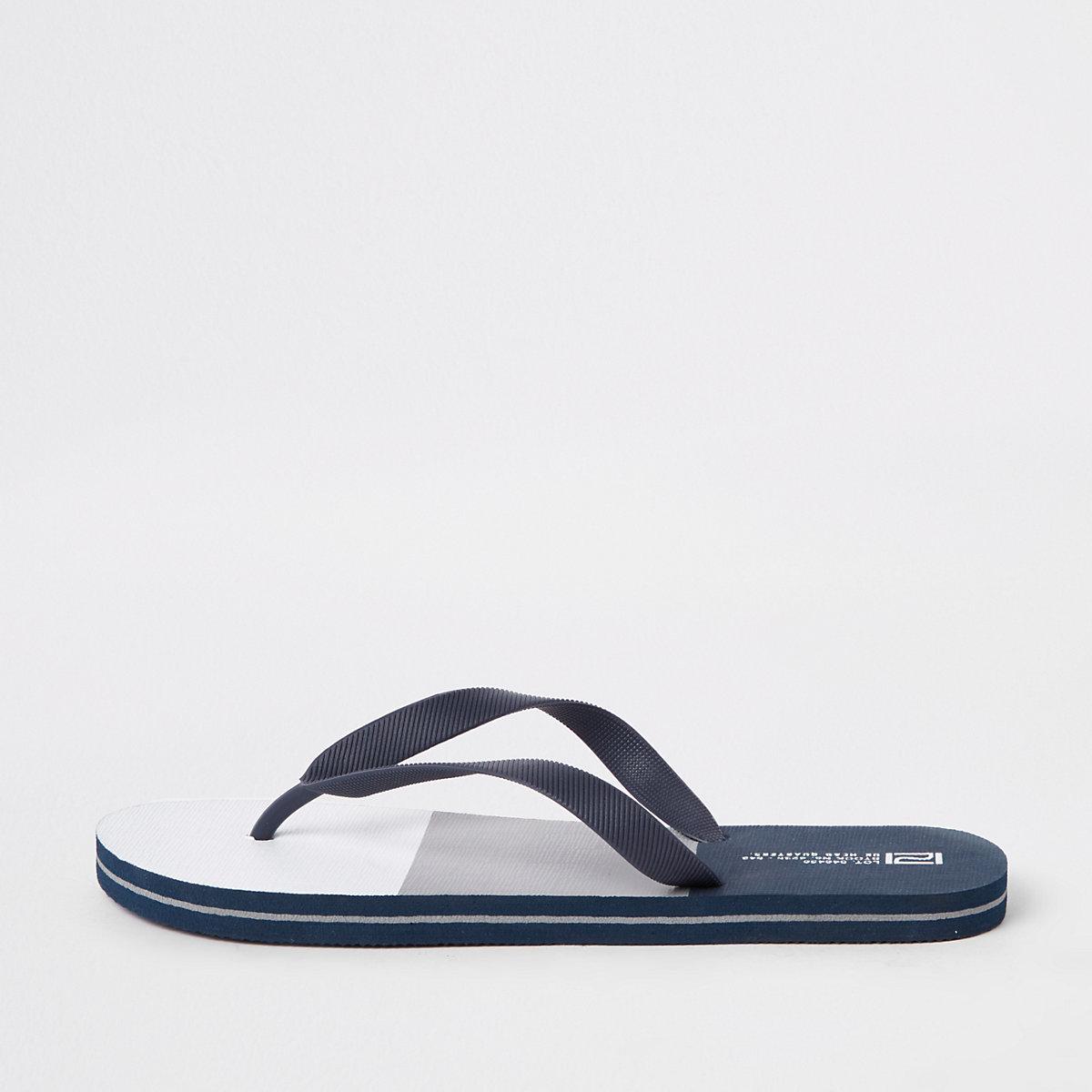 Grey colourblock flip flops