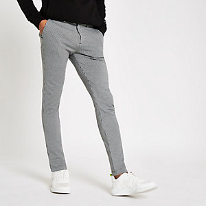 Black jersey dogtooth skinny fit trousers