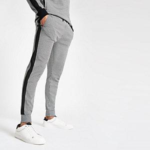 Pantalon de jogging slim motif pied-de-poule noir