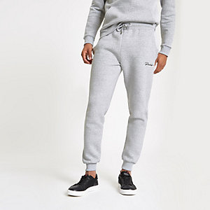 Graue Muscle Fit Jogginghose