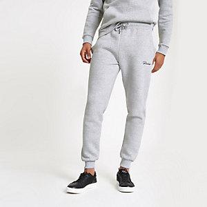 Pantalon de jogging ajusté gris brodé