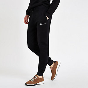 Black muscle fit embroidered joggers