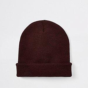 Bonnet large en maille torsadée rouge