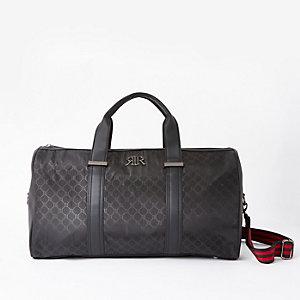 Schwarze Reisetasche mit RI-Monogramm