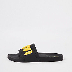 Black 'LXVI' embossed sliders