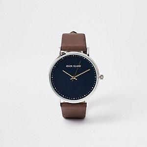 Bruin met zilverkleurig minimalistisch horloge