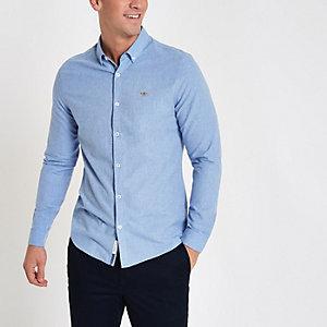 Chemise bleu clair à manches longues et broderie guêpe