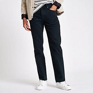 Donkerblauwe jeans met onafgewerkte zoom en rechte pijpen