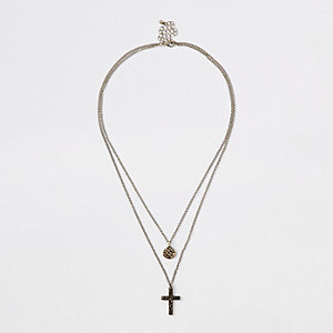 Gold tone disc and cross necklace