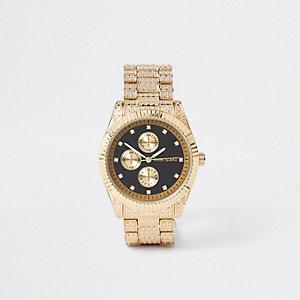 Goldene, strassverzierte Armbanduhr