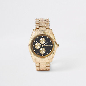 Gold tone rhinestone encrusted watch