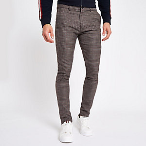 Brown dogtooth jersey skinny fit trousers