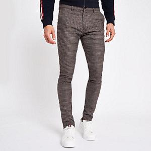 Pantalon skinny en jersey motif pied-de-poule marron