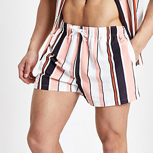 Coral stripe swim trunks