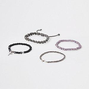 Set grijze armbanden met kralen en touw