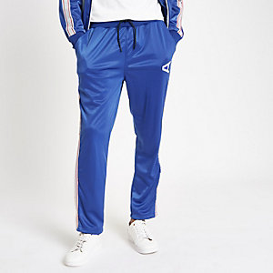 Arcminute – Pantalon de jogging bleu à bandes latérales