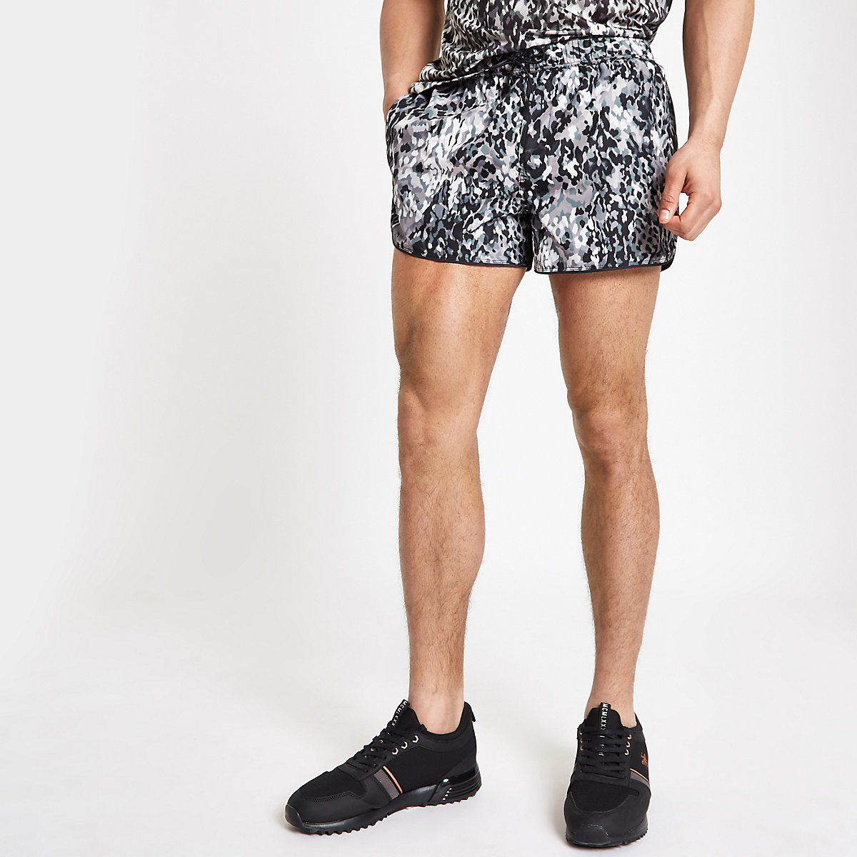 Black leopard print runner swim trunks