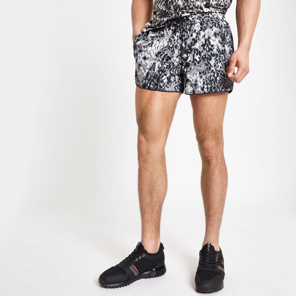Black leopard print runner swim trunks